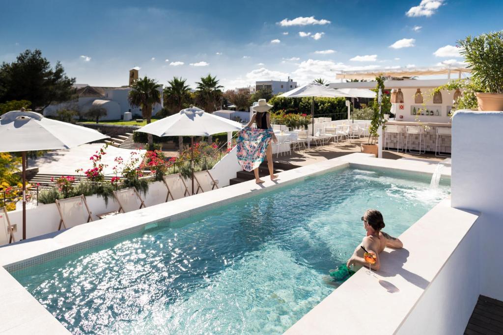 The swimming pool at or near Gatzara Suites Santa Gertrudis