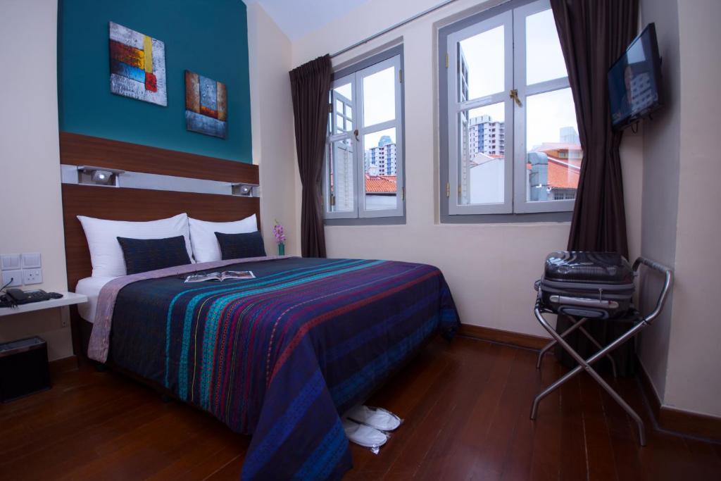 Un ou plusieurs lits dans un hébergement de l'établissement The Keong Saik Hotel