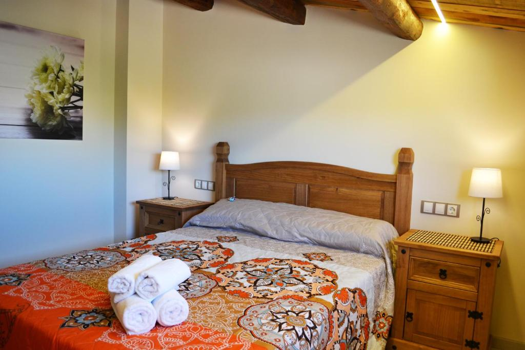 Tempat tidur dalam kamar di La Llacuna