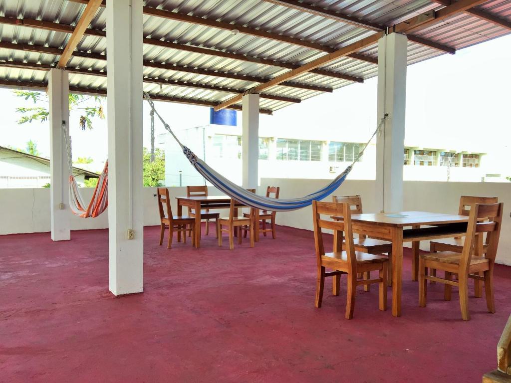 Restaurant ou autre lieu de restauration dans l'établissement Hostal El Paraiso