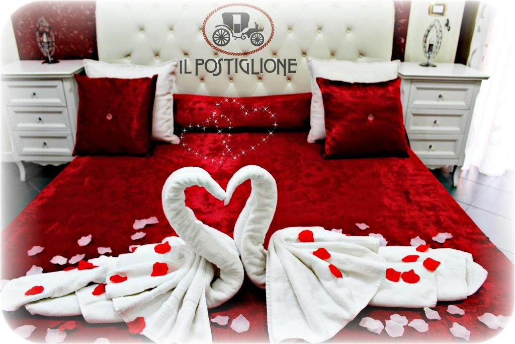 A bed or beds in a room at Il Postiglione