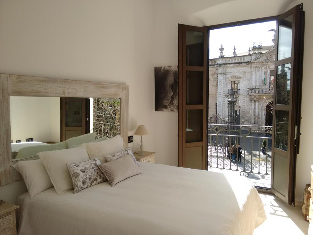 A bed or beds in a room at Apartamento San Fernando