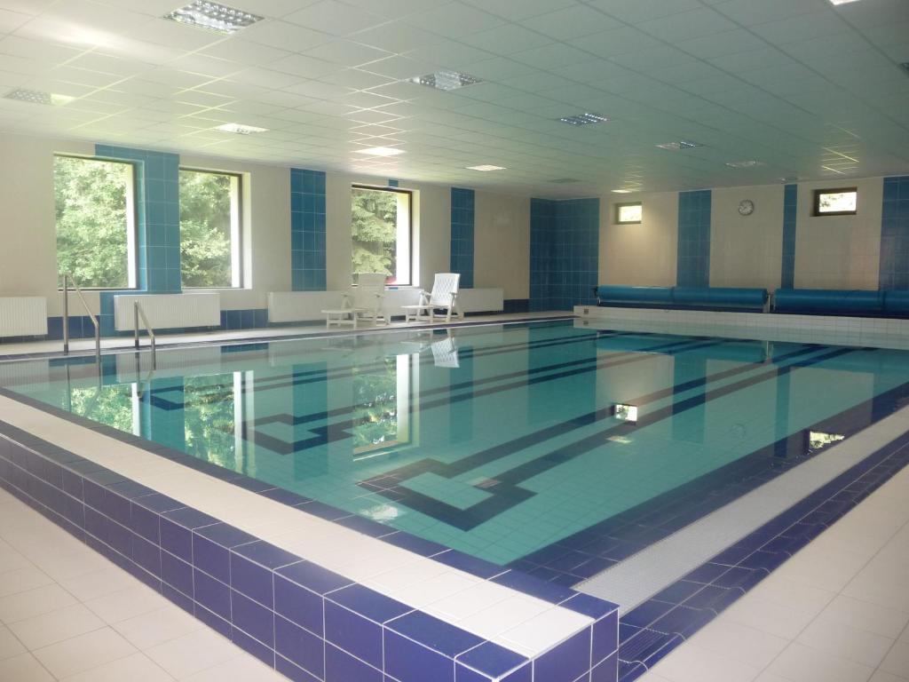 Bazén v ubytování Ernesta Club Lipno nebo v jeho okolí