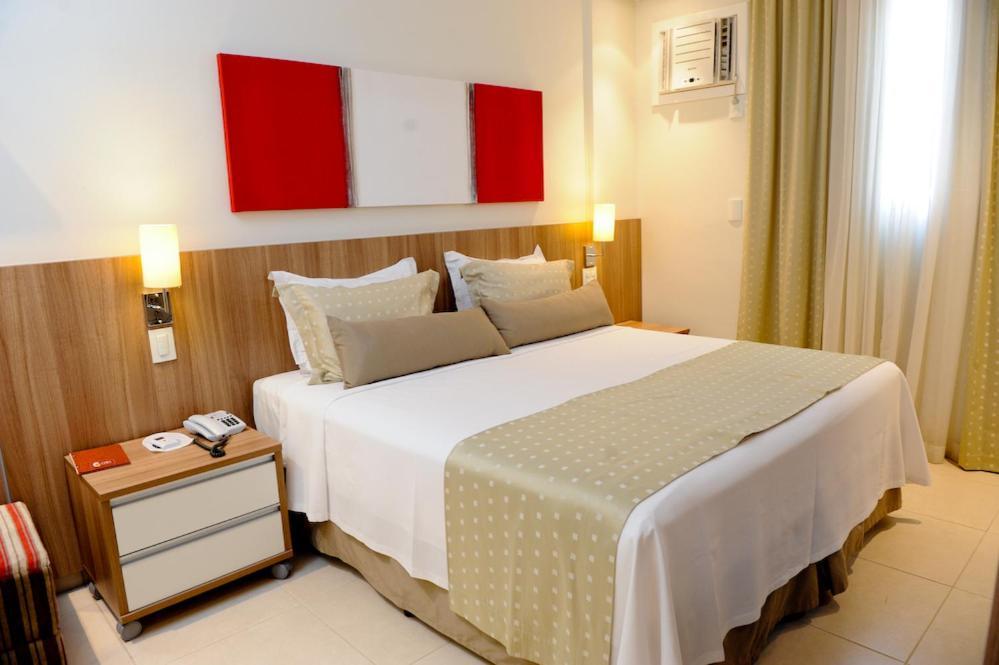 En eller flere senger på et rom på Faria Lima Flat Service