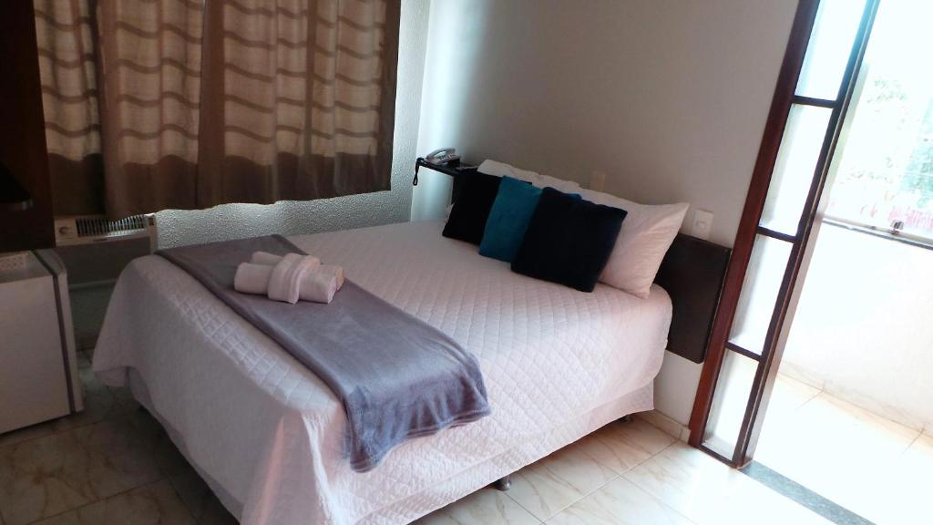 A bed or beds in a room at Hotel Vila Planalto
