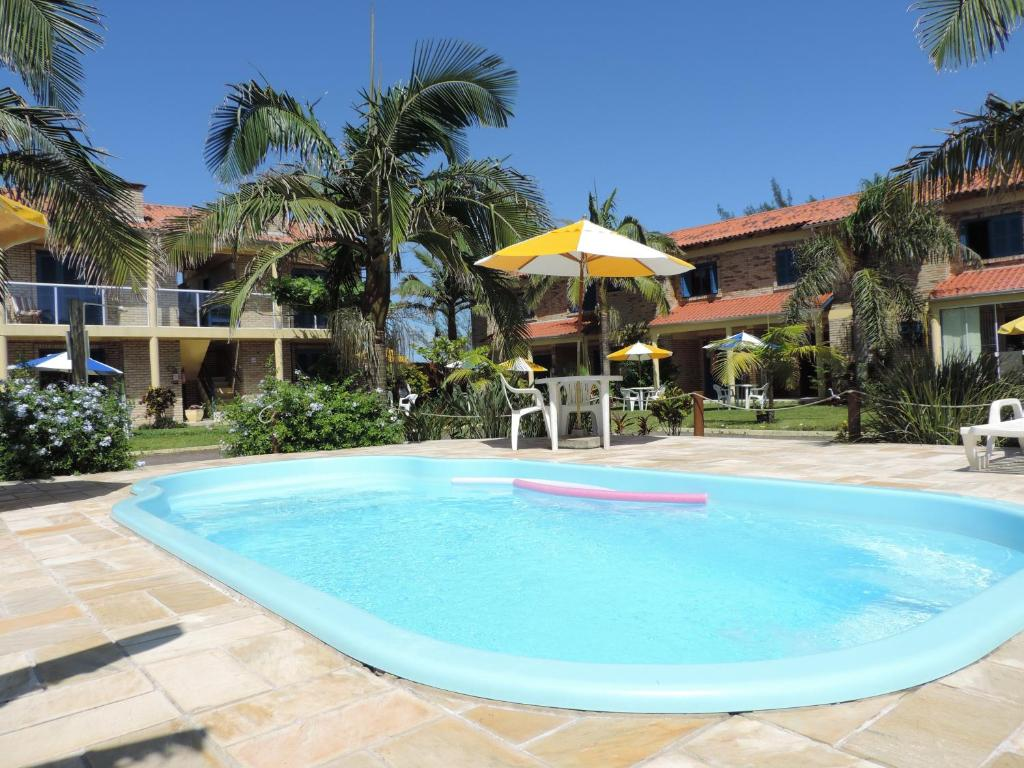 The swimming pool at or near Pousada Don Fernandes