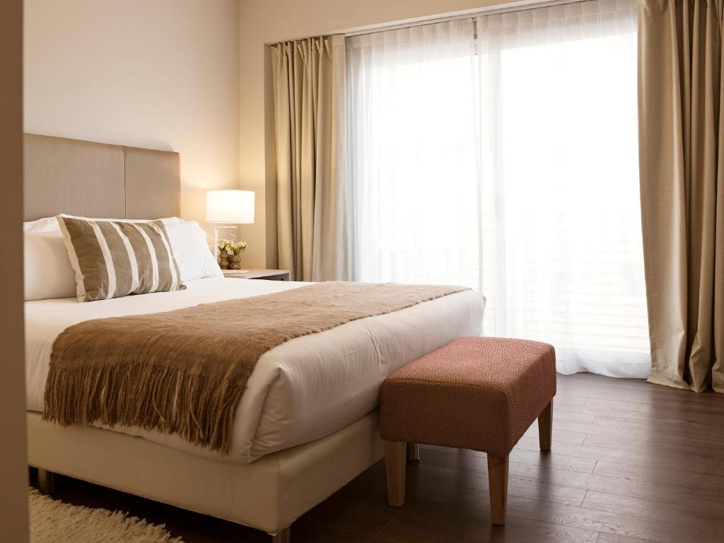 Cama ou camas em um quarto em Dazzler by Wyndham Polo
