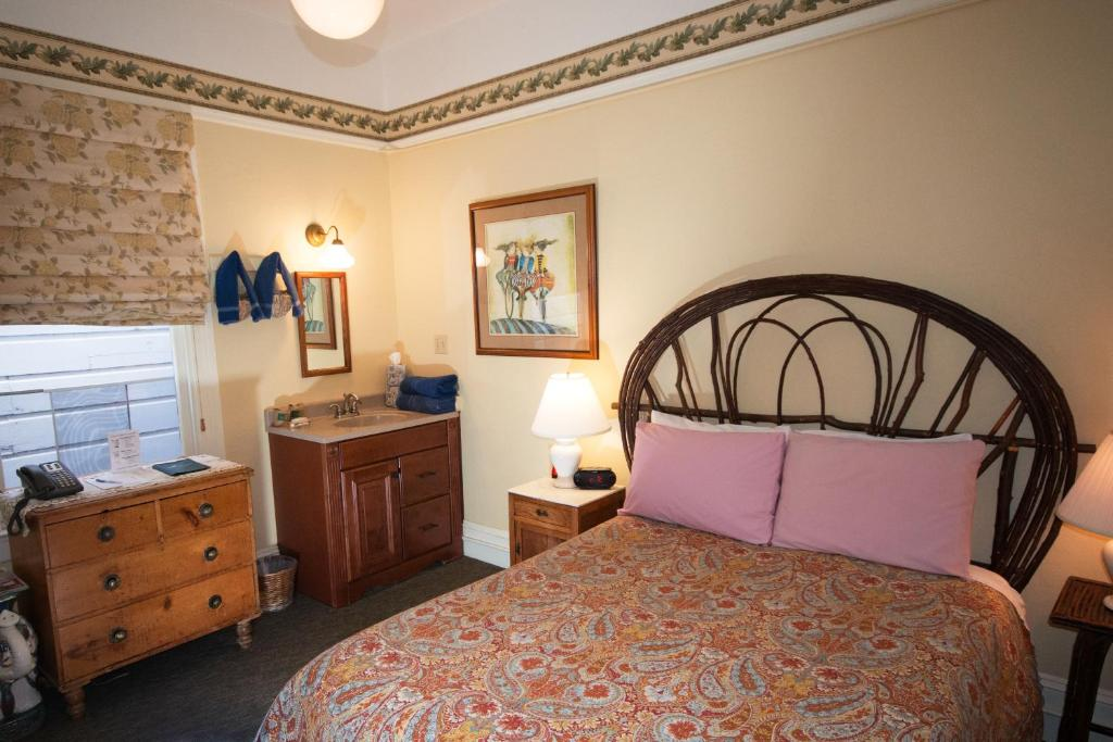 A bed or beds in a room at The Willows Inn