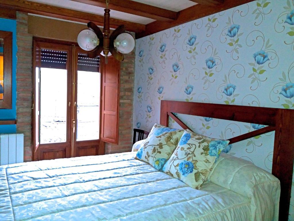Cama o camas de una habitación en La Alcoba de Becquer