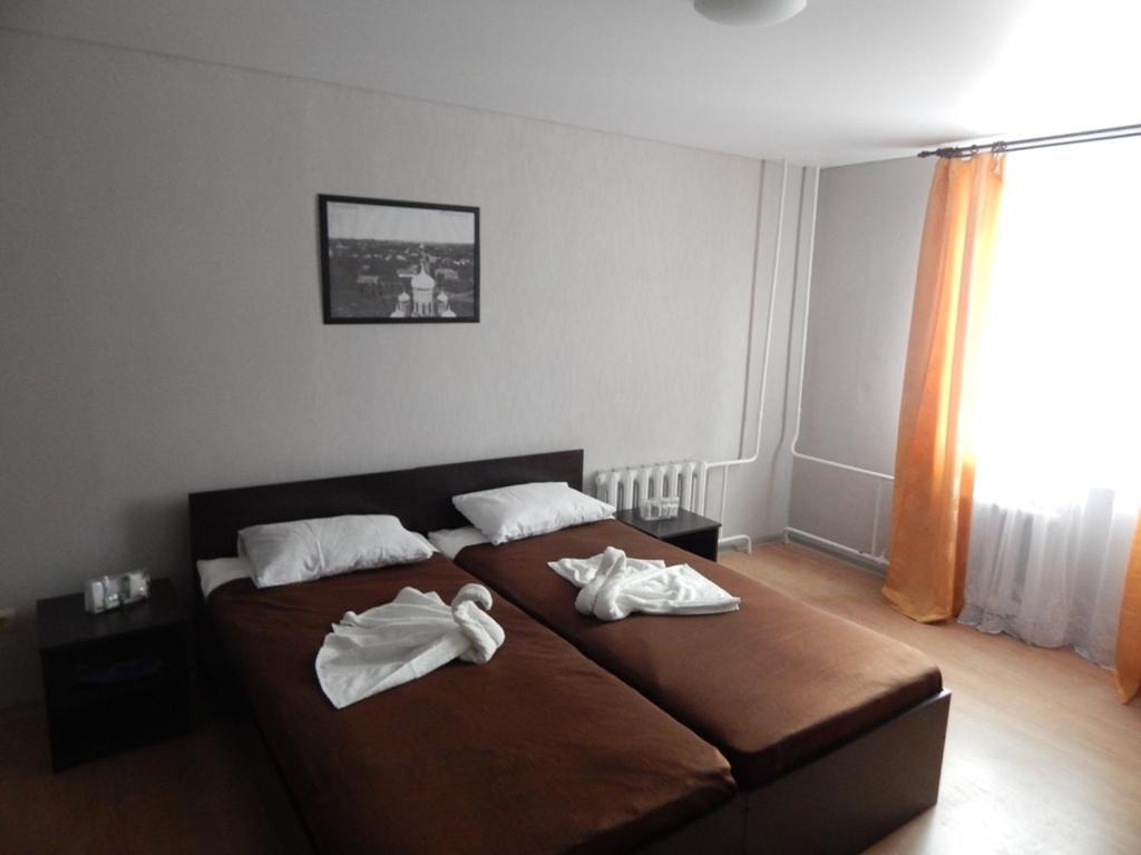 Кровать или кровати в номере Отель Базилик Скопин