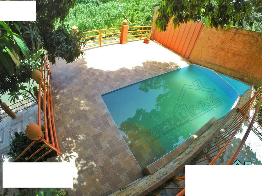 Vista de la piscina de Villa Ribera Del Yaque o alrededores
