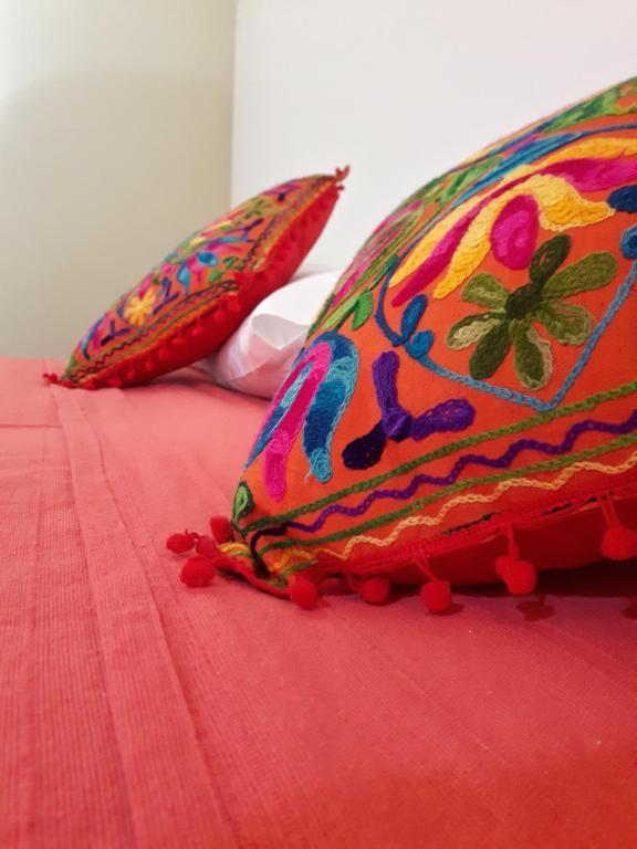 Una cama o camas en una habitación de Alto Colonia