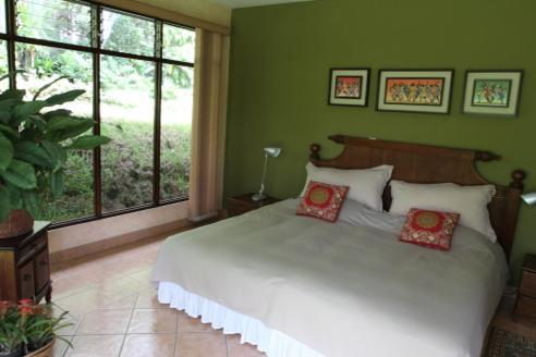 Cama o camas de una habitación en El jardín de Anabelle