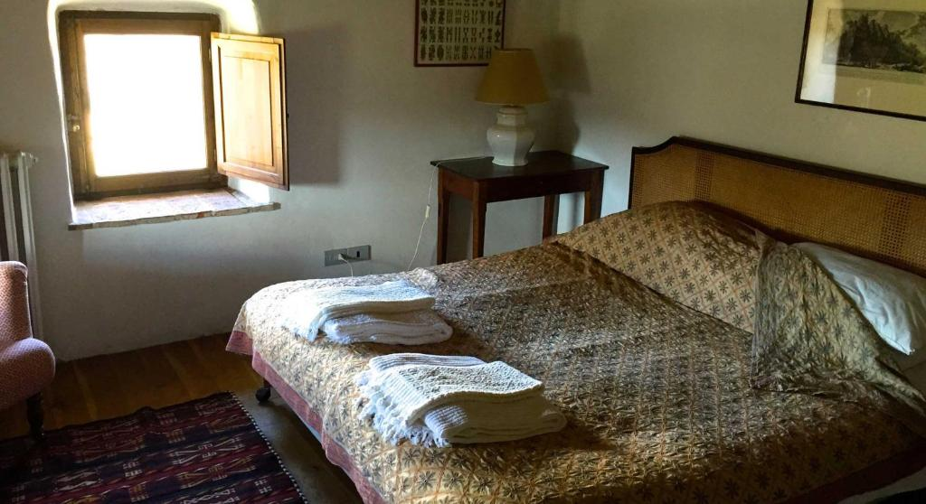 A bed or beds in a room at Castello Di Potentino