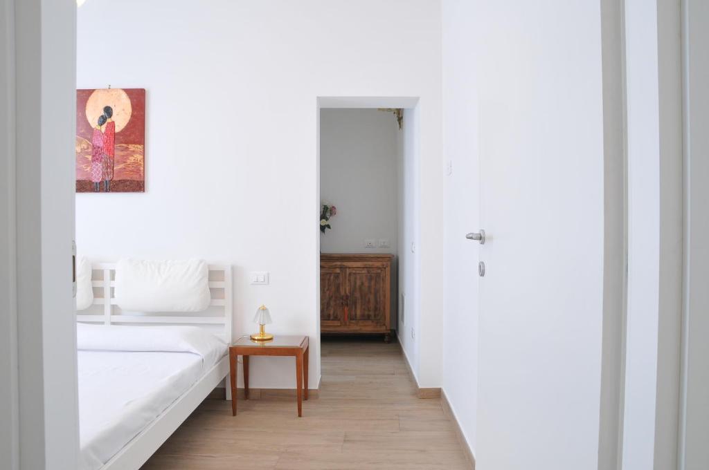 Letto o letti in una camera di Casa Cosami