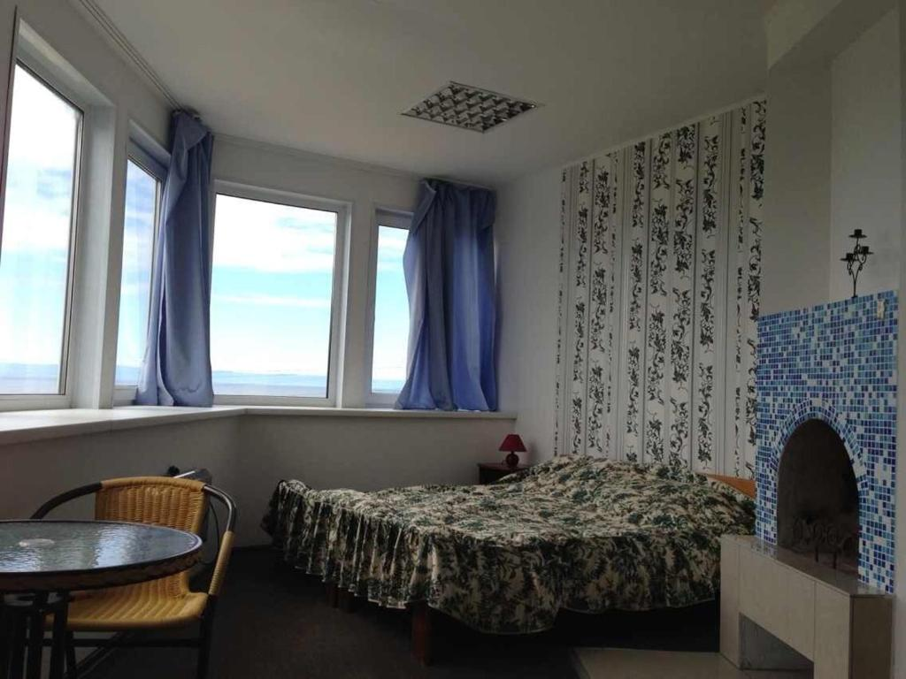 A bed or beds in a room at Guest House Baikal Sofia
