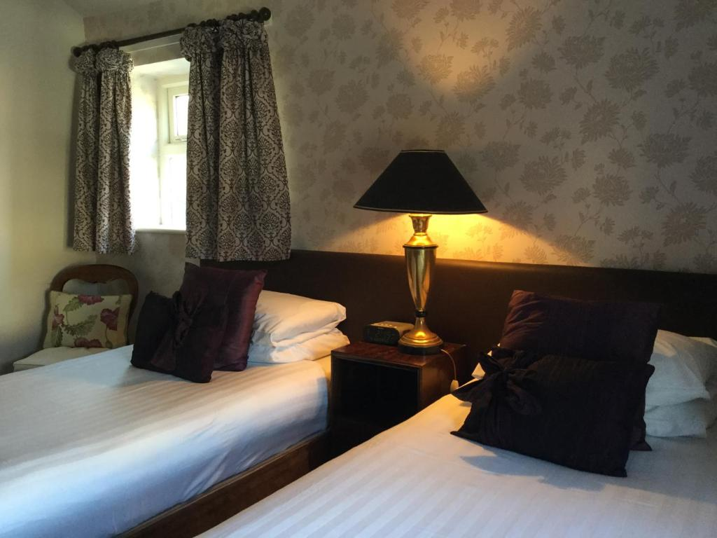 A bed or beds in a room at The lodge