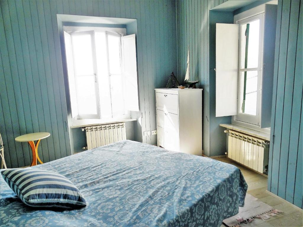A bed or beds in a room at House in Punta Chiappa