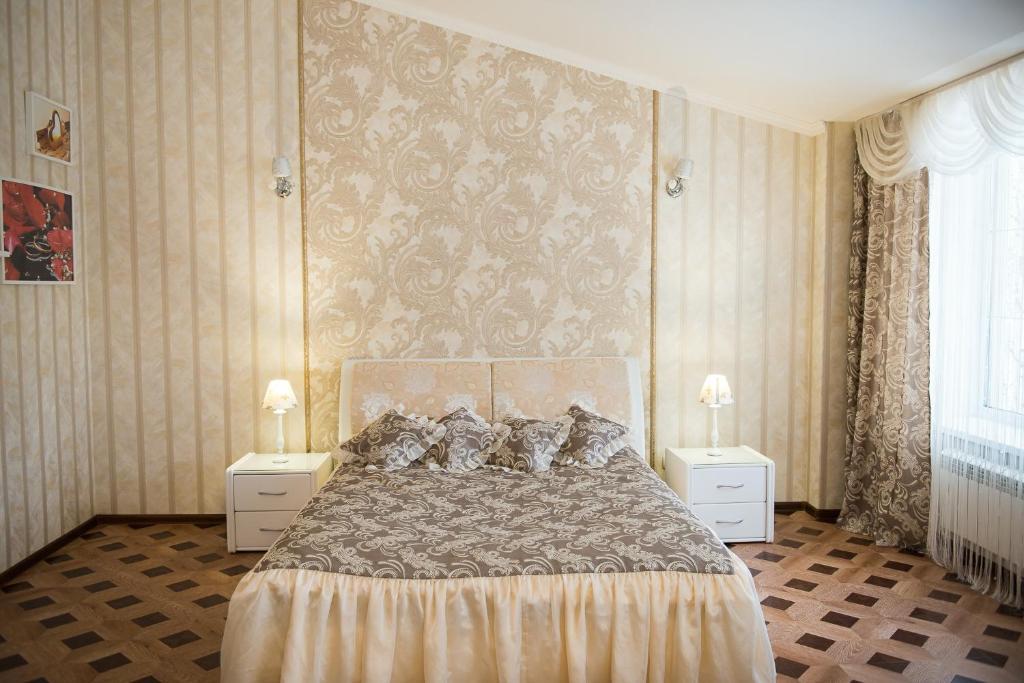 Кровать или кровати в номере Гостевой дом Bellagio