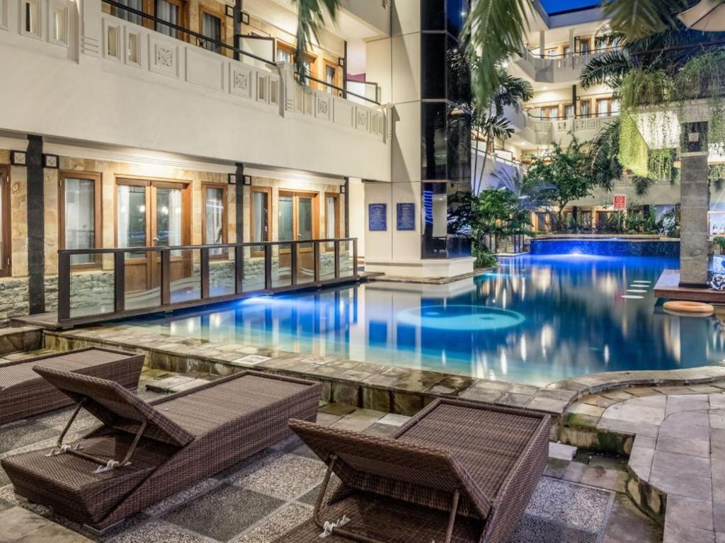 The swimming pool at or near Permata Kuta Hotel