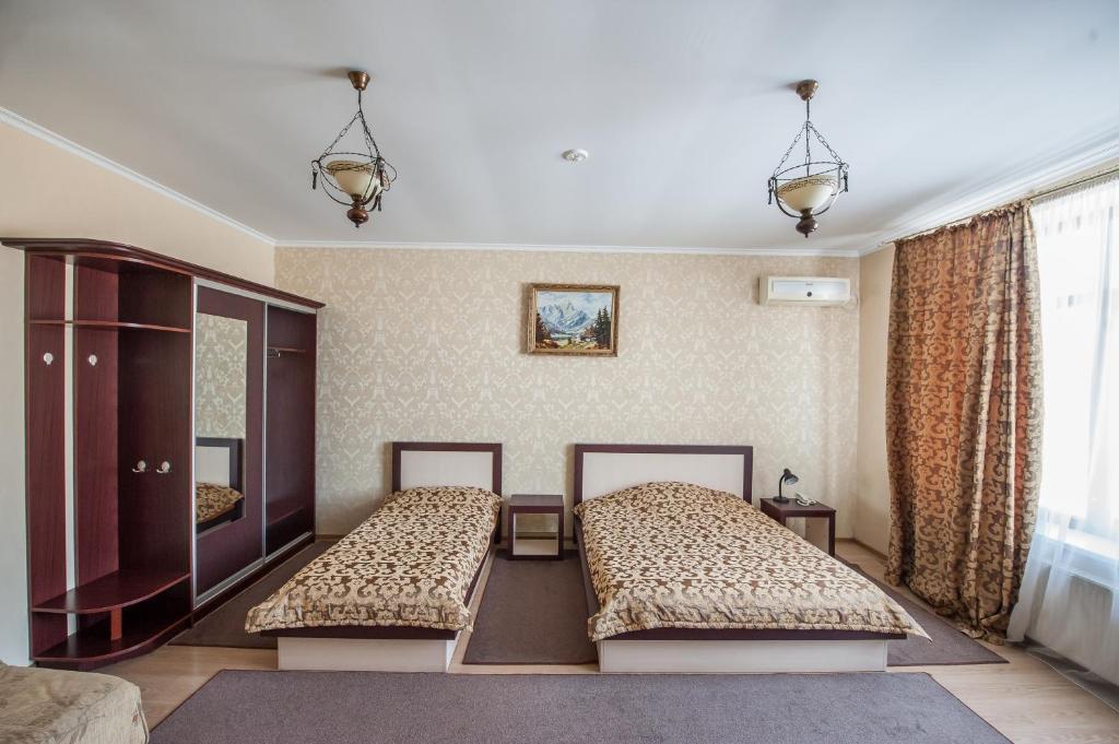 Ένα ή περισσότερα κρεβάτια σε δωμάτιο στο Stella de Lux Hotel