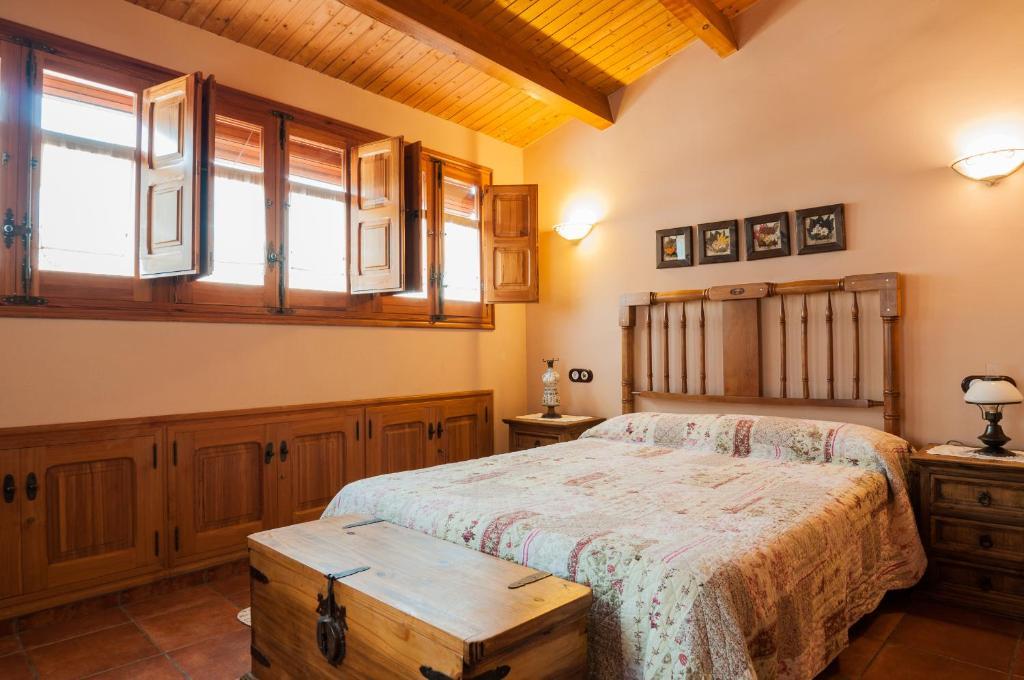 Cama o camas de una habitación en Casa Rural Rosa