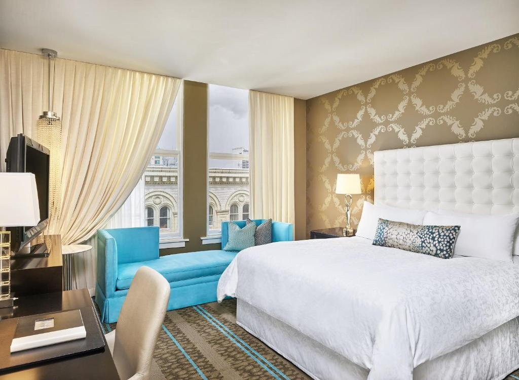A bed or beds in a room at The Nines, a Luxury Collection Hotel, Portland