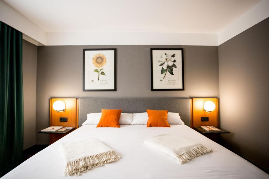 מיטה או מיטות בחדר ב-Hotel Malcom and Barret