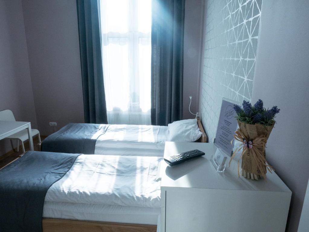 Ένα ή περισσότερα κρεβάτια σε δωμάτιο στο Just4You Apartments
