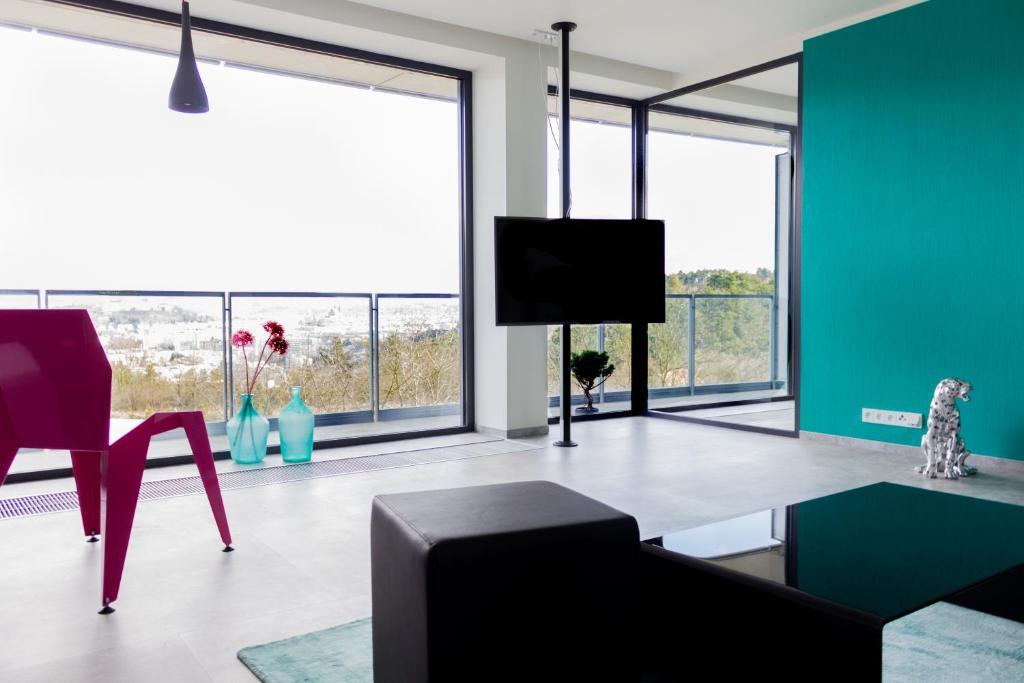 TV a/nebo společenská místnost v ubytování Amazing Apartments