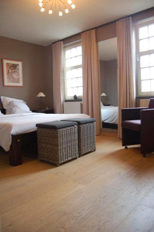 Cama o camas de una habitación en B&B De Peperbus
