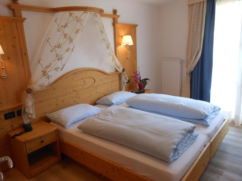 A bed or beds in a room at Il Falchetto
