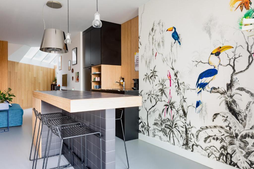 Una cocina o zona de cocina en Kith & Kin Boutique Apartments
