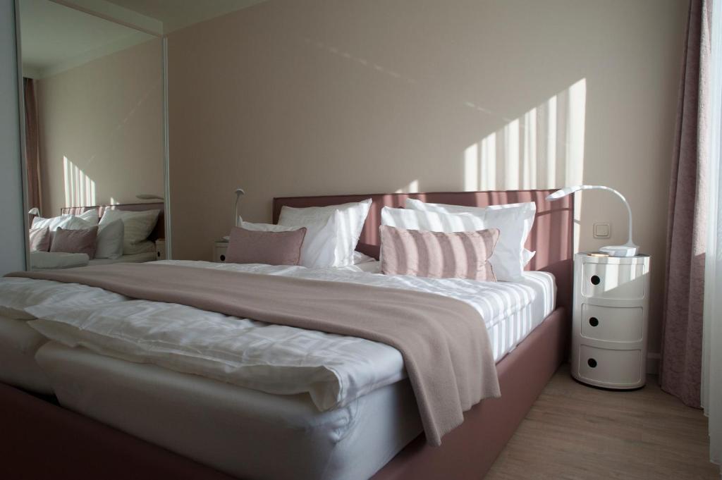 Ein Bett oder Betten in einem Zimmer der Unterkunft Antoinettes Ferienwohnung