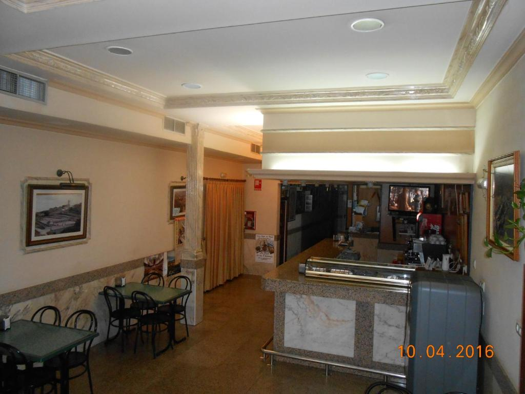 The lobby or reception area at Hotel Los Hermanos
