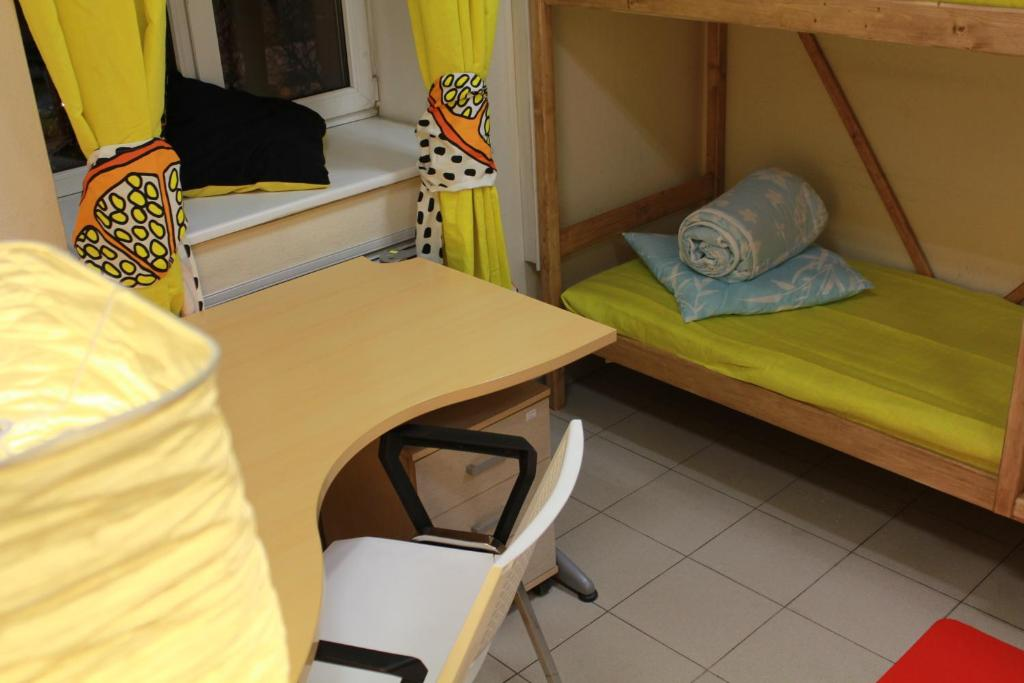 A bed or beds in a room at Hostel Vpechatlenie