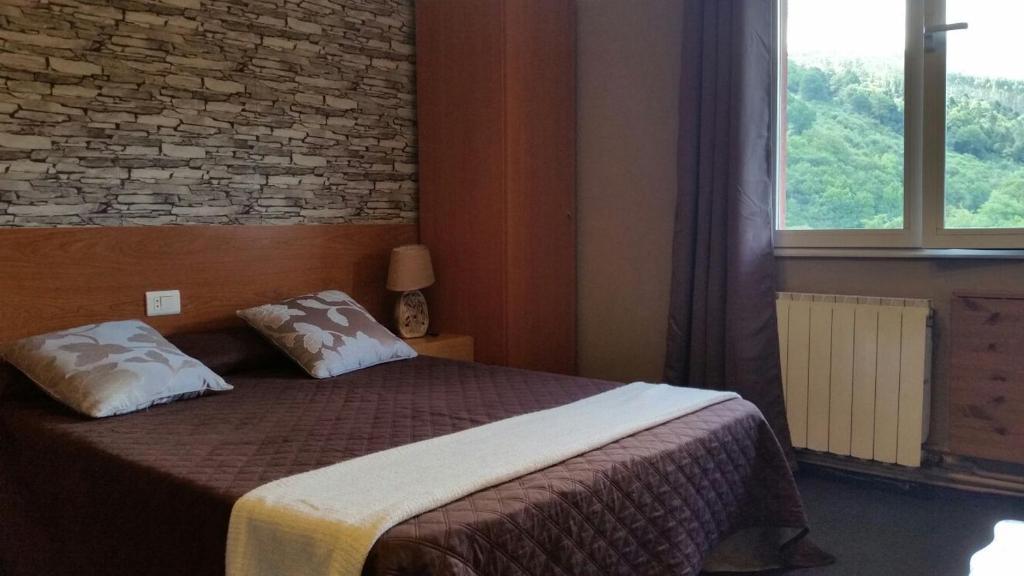 Cama o camas de una habitación en Pensión Bide-Ondo
