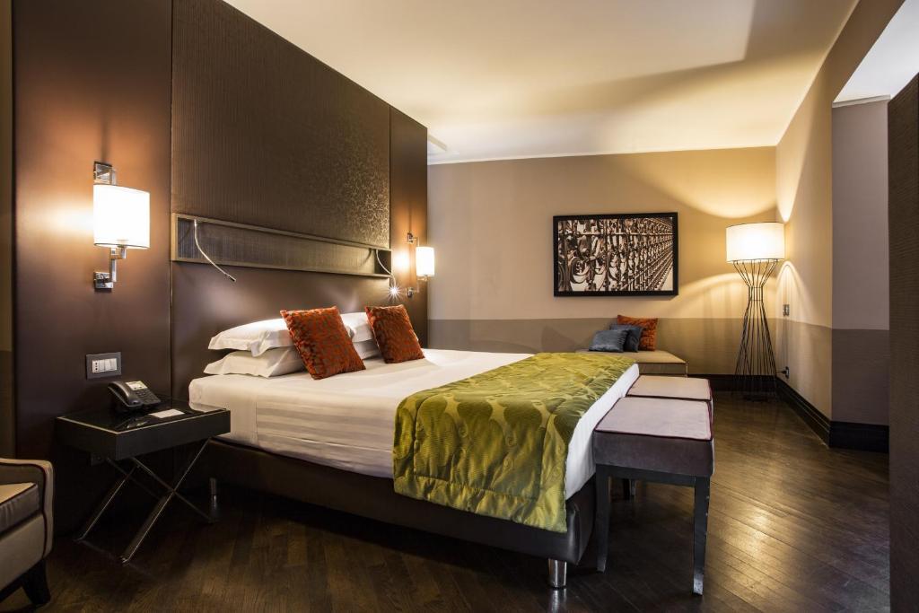 Cama o camas de una habitación en Rome Times Hotel