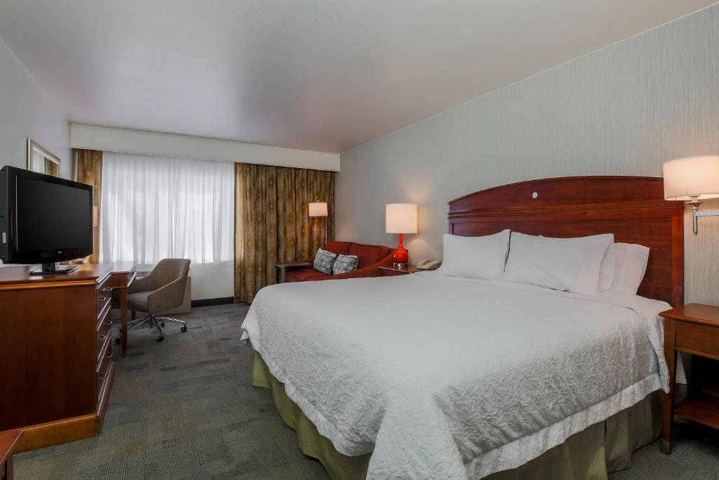 A bed or beds in a room at Hampton Inn Anchorage