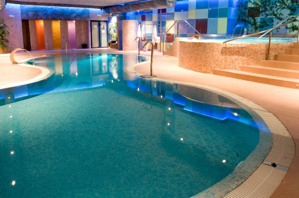 The swimming pool at or near Spa Hotel Ciudad de Teruel