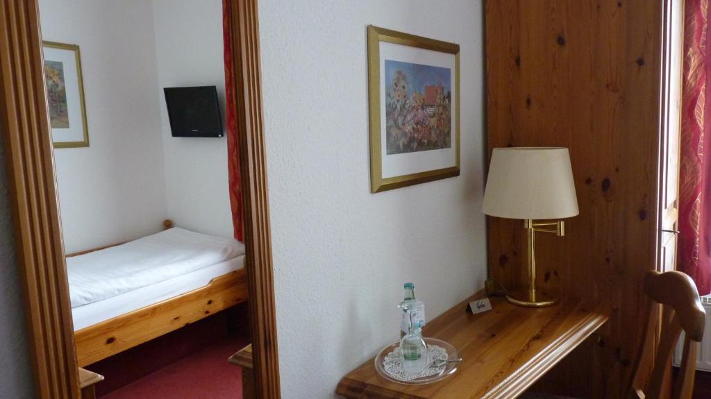 Ein Bett oder Betten in einem Zimmer der Unterkunft Gasthof Willenbrink