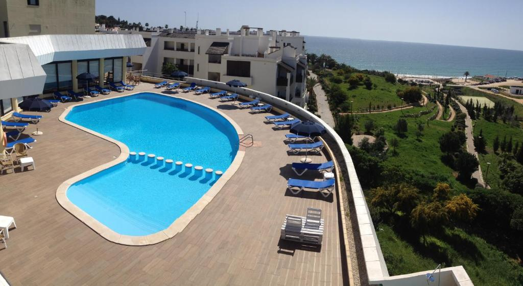 A view of the pool at Apartamentos Magnolia Mar or nearby