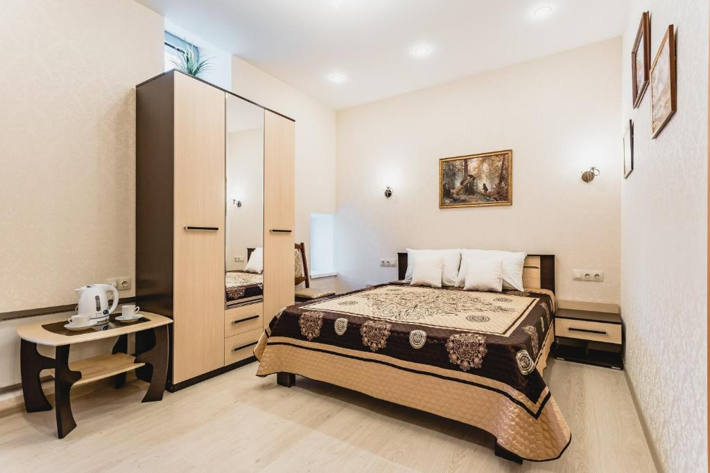 A bed or beds in a room at Hotel Marli