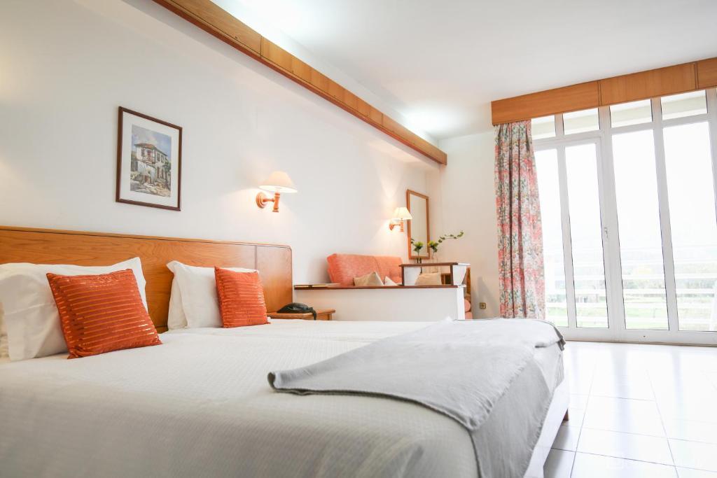 Uma cama ou camas num quarto em Hotel Apartamento Pantanha