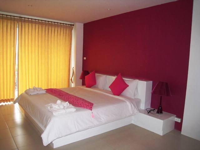 Ein Bett oder Betten in einem Zimmer der Unterkunft Massage Corner Guesthouse