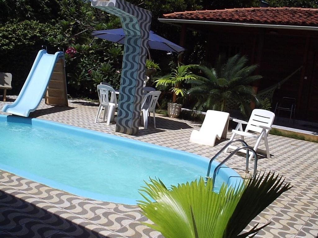 The swimming pool at or near Pousada das Flores