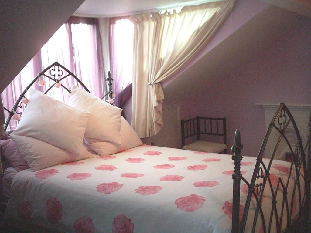 Un ou plusieurs lits dans un hébergement de l'établissement Melrose House