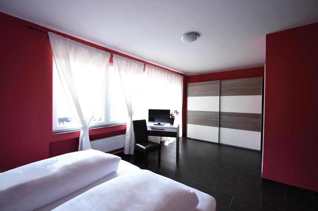Een bed of bedden in een kamer bij Hotel Dolce Vita