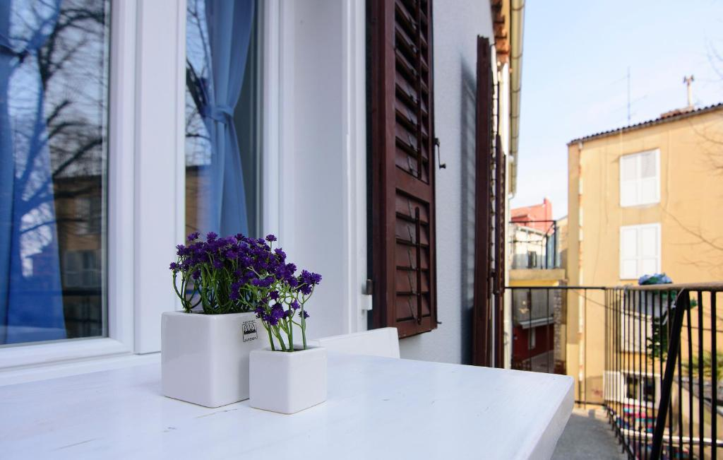 A balcony or terrace at Old City Rooms