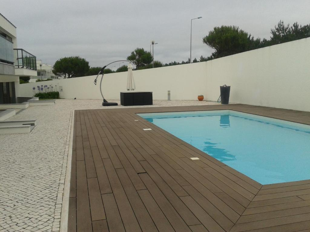 The swimming pool at or near Atlantico Village Apartment